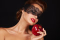 Beautiful sexy brunette woman with lace eating red apple healthy food tasty food organic diet smile healthy boac black background Stock Images