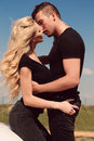 Beautiful sexy couple in casual  clothes posing beside auto Royalty Free Stock Photo