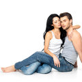 Beautiful sexy couple in love on white background dressed blue jeanse and white undershirt Royalty Free Stock Photo