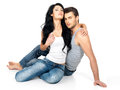 Beautiful sexy couple in love on white background dressed blue jeanse and white undershirt Royalty Free Stock Images