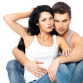 Beautiful sexy couple in love on white background dressed blue jeanse and white undershirt Stock Photo