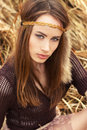 Beautiful sexy girl hippies sitting in the dry grass Royalty Free Stock Photos