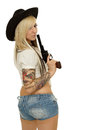 Beautiful sexy girl holding gun cowgirl on white background Royalty Free Stock Images