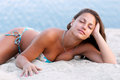 Beautiful sexy girl lying on the sandy beach Stock Photography