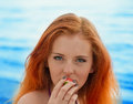 Beautiful sexy girl with red hair and bikini posing on a beach Stock Photos