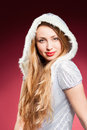 Beautiful sexy girl wearing santa claus clothes over red background Stock Photos