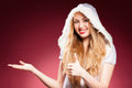Beautiful sexy girl wearing santa claus clothes over red background Stock Photography