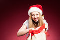 Beautiful sexy girl wearing santa claus clothes over red background Stock Images