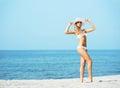 Beautiful, sexy lady wearing white hat and alluring swimwear Royalty Free Stock Photo