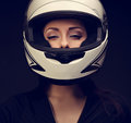Beautiful sexy makeup woman looking in white motorcycle helmet o Royalty Free Stock Photo