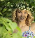 Beautiful sexy smiling girl with a wreath on his head in the spring park Royalty Free Stock Photo
