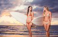 Beautiful Surfer Girls on the Beach Royalty Free Stock Photo