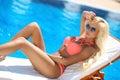 Beautiful sexy woman bikini model posing and tanned on deck chai Royalty Free Stock Photo