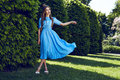 Beautiful sexy woman brunette walk in park sun shine dress Royalty Free Stock Photo