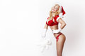 Beautiful and sexy woman dresses as a sexy santa claus Royalty Free Stock Photo