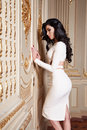 Beautiful sexy woman in elegant dress fashionable autumn Collection of spring long brunette hair makeup tanned slim body figure ac Royalty Free Stock Photo