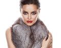 Beautiful sexy woman in furs makeup makeup jewelry young brunette with bright evening make up red lips wearing a slinky silk dress Stock Photography