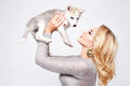 Beautiful sexy woman hug pets dog makeup dress blond Royalty Free Stock Photo
