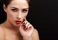 Beautiful sexy woman portrait. Black eyeliner, red lipstick and black nails polish Royalty Free Stock Photo