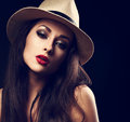 Beautiful sexy woman posing in cowboy summer hat with bright red