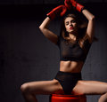 Beautiful sexy woman with red Boxing Gloves at the gym concept a Royalty Free Stock Photo
