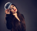 Beautiful sexy young make-up model in blue baseball cap with red Royalty Free Stock Photo