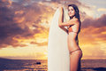 Beautiful sexy young surfer girl in bikini on the beach at sunse sunset Stock Images