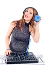 Beautiful sexy young woman as dj playing music on pickup mixer isolated a white background studio shot Stock Image