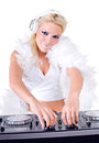 Beautiful sexy young woman as dj playing music on pickup mixer isolated a white background studio shot Stock Photo