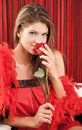 Beautiful sexy young woman smelling a red rose  Royalty Free Stock Photo