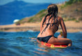 Beautiful sexy young woman surfer girl waiting for a wave Royalty Free Stock Photo