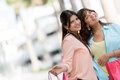 Beautiful shopping girls portrait of smiling and looking happy Royalty Free Stock Images