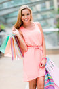 Beautiful shopping woman holding bags and smiling Stock Photo