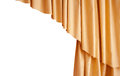 Beautiful silk golden curtain isolated on white background Royalty Free Stock Photo