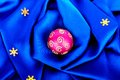 Beautiful silk wavy fabric blue with pink sphere and gold stars Royalty Free Stock Image