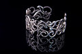Beautiful silver bracelet on black background Royalty Free Stock Images