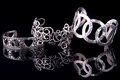 Beautiful silver bracelets on black background Royalty Free Stock Photos