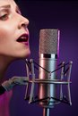 Beautiful singer at concert Royalty Free Stock Image