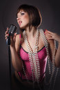 Beautiful singer singing with a retro microphone Royalty Free Stock Image