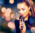 Beautiful singing girl beauty woman with microphone Royalty Free Stock Images