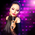 Beautiful singing girl beauty woman with microphone Royalty Free Stock Photos
