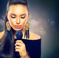 Beautiful singing girl beauty woman with microphone Royalty Free Stock Photo