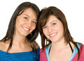 Beautiful sisters over white Royalty Free Stock Photos