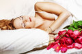 Beautiful slepping woman with red roses Royalty Free Stock Photos
