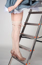 Beautiful slim female legs on the stairway Stock Photo