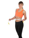 Beautiful slim woman measuring her waistline with a measuring tape Stock Photos