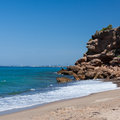 Beautiful small beach in spain sandy with rock and tree Stock Photography