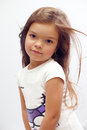 Beautiful small girl with streaming hair. studio Stock Photo