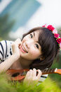 Beautiful smile asian woman with Ukulele in garden Royalty Free Stock Photography