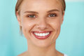 Beautiful smile smiling woman with white teeth beauty portrait closeup of happy young perfect fresh face and healthy soft skin Royalty Free Stock Images